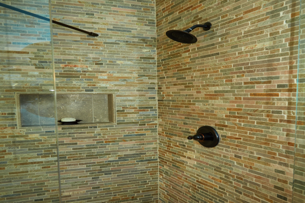 glass shower with stone walls